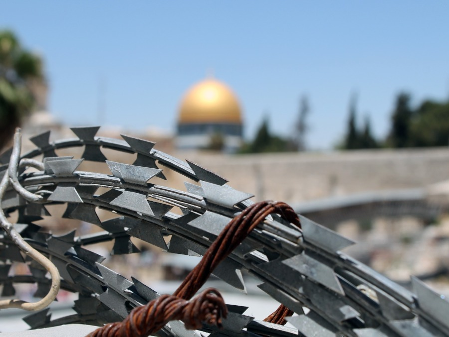 An image of barbed wire in Jerusalem. What does it mean to be an apartheid state?